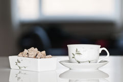 Tea cup with brown sugar Stock Images