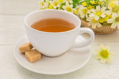 Tea cup and brown sugar cubes Stock Photo