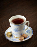 Tea cup and brown sugar cubes Royalty Free Stock Photography