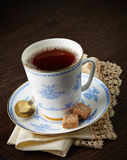 Tea cup and brown sugar cubes Royalty Free Stock Images