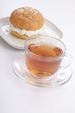 Tea cup and bun with sesame royalty free stock photography