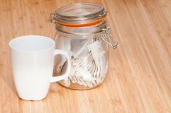 Tea cup with caddy Royalty Free Stock Photography