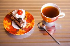 Tea cup and cake Stock Photography