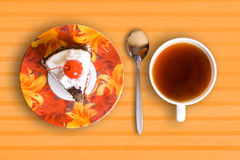 Tea cup and cake Stock Image