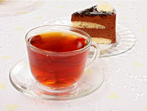 Tea cup and cake slices Royalty Free Stock Photo