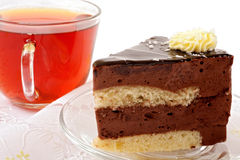 Tea cup and cake slices Stock Images