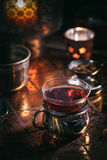 Tea in cup and candles Stock Photo