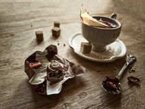 Tea cup and candy Stock Image