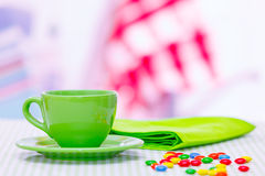 Tea cup and candydragees on the table Stock Photo