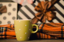 Tea in a cup and christmas gifts stock photography
