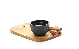 Tea cup, cinnamon and star anise on wooden board Stock Photography
