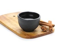 Tea cup, cinnamon and star anise on wooden board Stock Photo