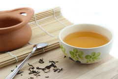 Tea in a cup and Clay pot and spoon Stock Photo