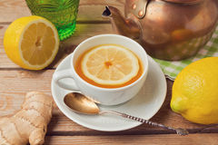 Tea cup close up with ginger and lemon Stock Photos