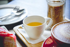 Tea cup and coffee and cake on wood table in restaurant Stock Images