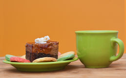 Tea cup with colorful cookies Royalty Free Stock Image