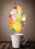 Tea cup with colorful speech bubbles Royalty Free Stock Images