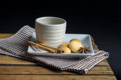 Tea cup with crackers Stock Images