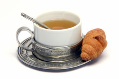 Tea cup and croisant Stock Photo