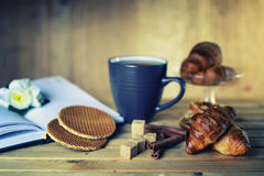 Tea cup croissant book. The concept of food and drink preparation process of its objects and elements Royalty Free Stock Photography
