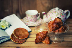 Tea cup croissant book. The concept of food and drink preparation process of its objects and elements Stock Photography