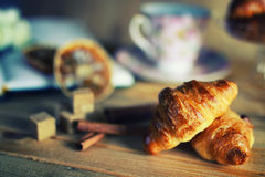 Tea cup croissant book Royalty Free Stock Images
