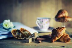 Tea cup croissant book Royalty Free Stock Photography