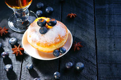Tea cup and donut with blueberry Royalty Free Stock Images