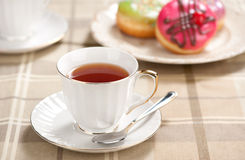 Tea cup and doughnuts Stock Photo