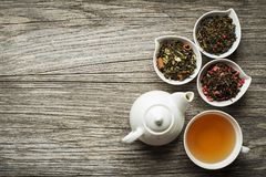 Tea in cup with dry tea collection stock photography