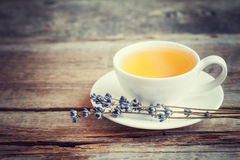 Tea cup and dry lavender flowers on table. Royalty Free Stock Photo