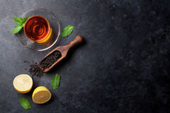 Tea cup and dry tea in spoon Stock Image