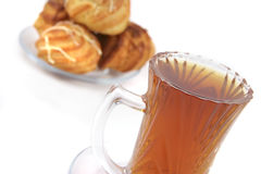 Tea cup and eclairs with strawberry Royalty Free Stock Images