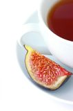 Tea cup and fig fruit Royalty Free Stock Photo