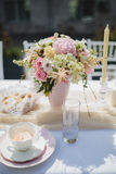 Tea cup and flowers, decoration for breakfast Royalty Free Stock Photo