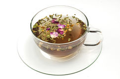 Tea cup with flowers. Cup with tea and dried flower petals Royalty Free Stock Images