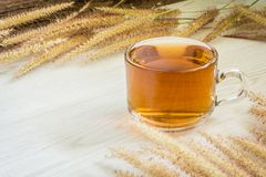 Tea cup and Flowers grass on white wooden background. Nature with vintage style, Morning with hot tea Stock Photos
