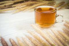 Tea cup and Flowers grass on white wooden background. Nature with vintage style, Morning with hot tea Stock Image