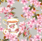 Tea cup and flowers. Seamless floral pattern. Watercolour design on paper background Stock Photo