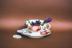 Tea cup with flowers. And sweets royalty free stock image