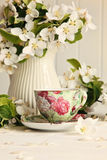 Tea cup with fresh flower blossoms Royalty Free Stock Images