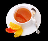 Tea cup and Fruit candy. A cup of tea with Fruit candy. Black background Stock Image