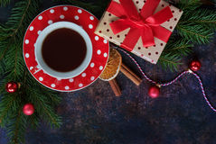 Tea cup with gift Royalty Free Stock Photos