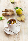 Tea cup and ginger Royalty Free Stock Images