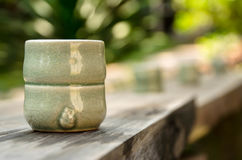 Tea cup. Green ceramic teacup on wooden table Royalty Free Stock Photo
