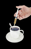 Tea cup with a hand using a syringe Royalty Free Stock Photo