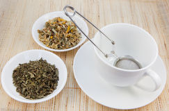 Tea cup and herbal teas Royalty Free Stock Photos