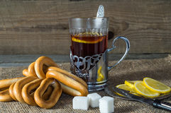 Tea in the Cup holder with bagels,suger and lemon. Stock Image