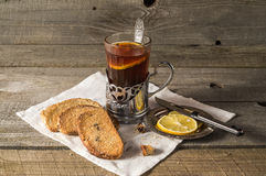 Tea in the Cup holder with lemon and crackers. Royalty Free Stock Photography