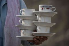 Tea cup holding technique - Pakistani Driver hotel Royalty Free Stock Images